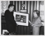 William L. Guy and Dorothy Stickney with drawing of North Dakota Heritage Center, Bismarck, N.D.