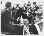 William L. Guy and Quentin Burdick with President John F. Kennedy in car, University of North...