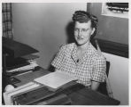 Dr. Anne Carlsen at desk