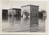 View of Mandan Post Office and nearby buildings under water, Mandan, N.D.