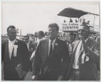 Myron H. Bright, John F. Kennedy, and Joe Poer leaving Quentin Burdick's birthday party, Fargo, N.D.