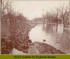 Floating wood pavers on 8th Street So., Fargo, N.D. during the flood of 1897.