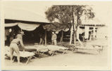 Soldiers in open air bunkhouse.