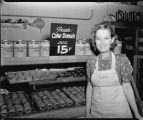 Woman at bakery display case, Red Owl Supermarket, Fargo, N.D.