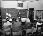 Student giving speech in classroom, North Dakota State Agricultural College, Fargo, N.D.