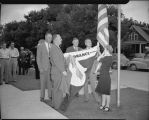 Hanging the Chicago Ordinance District flag at Dakota Tractor and Equipment Co., Fargo, N.D.
