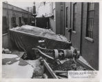 Excavating in alley for pipe vault, Northern States Power Co. steam plant, Fargo, N.D.