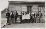Men in front of Ameina and Sharon Land Company office, Amenia, N.D.