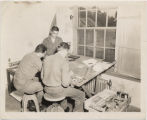 Psychological warfare staff. 8th United States Army, working on leaflets, Korea