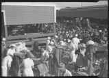Crowd around food tables at Armour Plant, West Fargo, N.D.