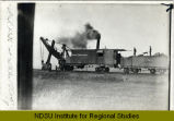 Great Northern Railroad steam shovel on tracks