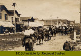 Horse parade on street, Mandan, N.D.