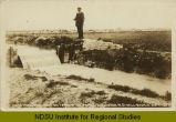 Measuring water on irrigation canal, Williston, N.D. - Williston distance