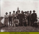 Group of men in front of tent