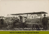 Early biplane at street fair, Noonan, N.D.