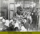 Crowd inside Herbst Department Store entrance, Fargo, N.D.
