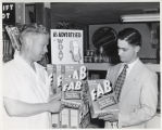 Two men beside display of FAB laundry detergent