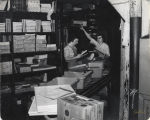 Two women pulling orders from warehouse area, Northern School Supply, Fargo, N.D.