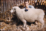 Young man with prize sheep