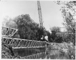 Construction of temporary bridge over the Red River, Fargo, N.D.