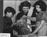Richard, Anne and Peggy Critchfield giving their dog a bath