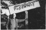 Richard Critchfield by sign for village of Popowlany, Poland