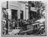 Long line of people in front of First National Bank, Fargo, N.D.