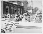 Earl and Marie Reineke and Fargo Mayor Herschel Lashkowitz in 1958 WDAY Band Festival parade,...