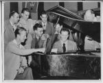 Don Roseland playing piano in Studio A, WDAY,Fargo, N.D.