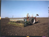 Spring seeding time with power drill, the drill is equiped with fertilizer attachment, John Scott farm,