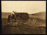 Lena Brennan on horse by her homestead house, Mountrail County, N.D.