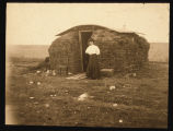 Amelia Brennan in front of her sod homestead shack Mountrail County, N.D.