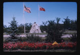 Stone cairn with American and Canadian flags at Internation Peace Garden, Dunseith, N.D.