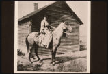 Mathilda Esoline Evenson on horse by homestead shack