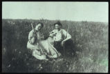 Esoline Mathilda Evenson and Oscar Zacherson sitting on prairie