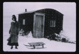 Lucy Goldthorpe with sled outside her homestead shack, Williams County, N.D.