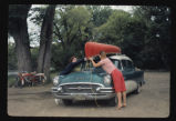 Unloading canoe from automobile