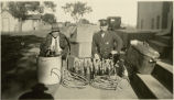 Police with alcohol taken from a bootlegger, Grafton, N.D.