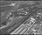 Aerial over Northern Pacific Railroad roundhouse, yards and downtown Mandan, N.D. during flood