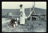 Grace Jacobsen with dog on her homestead, Grant County, N.D.