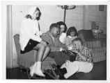 Foster family trying on skates, Fargo, N.D.