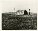 Sod house with windmill