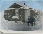 Ole Aune and his homestead shack, Cappon, Alberta, Canada : reading a letter from back home