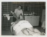Bill Henry giving a massage, YMCA, Fargo, N.D.