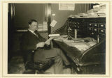 S. A. Olsness in his office, North Dakota Dept. of Insurance
