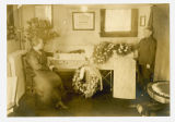 Woman and boy beside casket