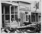 Damage to the College Grocery Store, College Barber Shop, and College Inn after the tornado on June 20,
