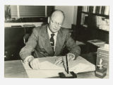 Conrad W. Leifur at his desk