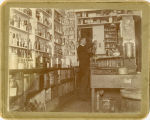 Lars Christianson inside his drugstore at 402 Front Street