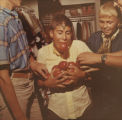 Bobbing for apples at Teennight, Herbst Department Store, Fargo, N.D.